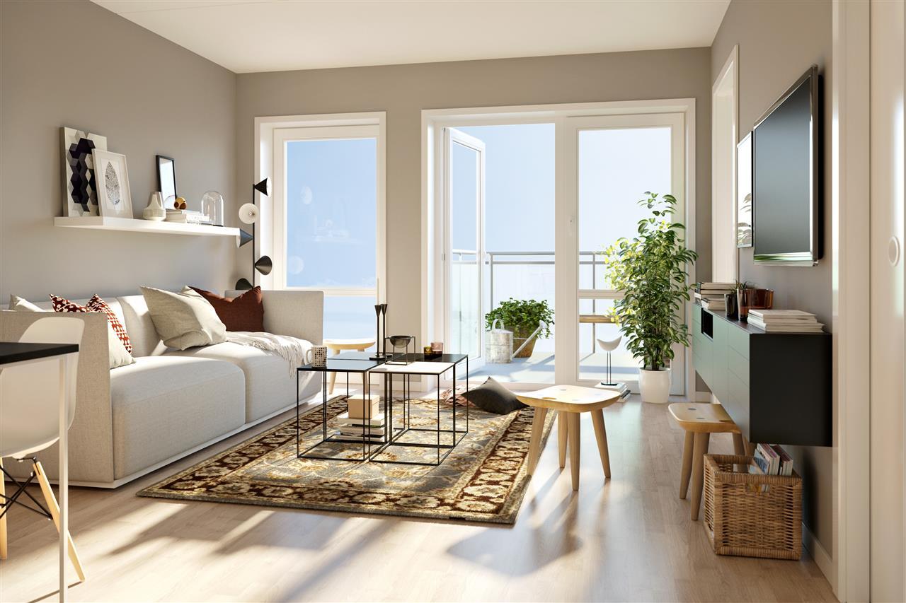 TV stue med lyse møbler og bord